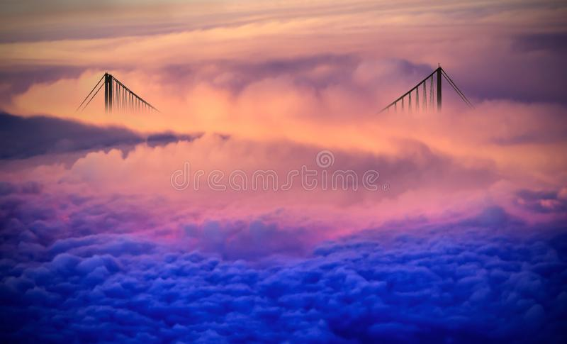 Bridge over the clouds stock photos