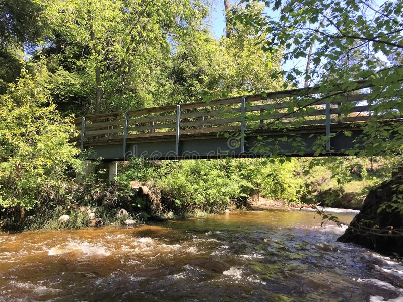 Bridge over a creek stock images