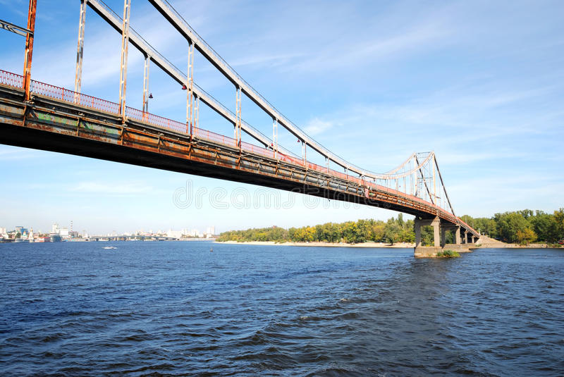 Bridge over the Dnieper river. Bridge over the water of Dnieper river. Industrial landscape royalty free stock photo