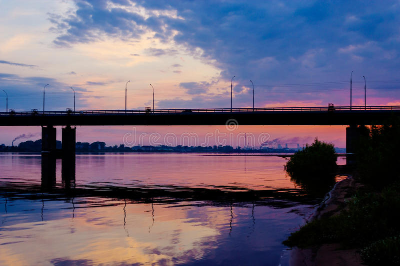 Bridge over dvina. Bridge over the Northern Dvina River in Arkhangelsk at sunset stock image