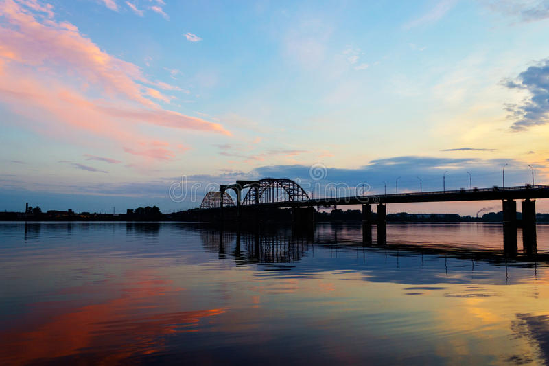 Bridge over dvina. Bridge over the Northern Dvina River in Arkhangelsk at sunset royalty free stock photography