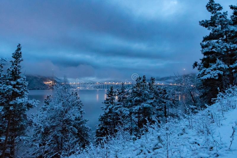 Bridge over Fjord Hardanger winter night. Fall royalty free stock photos