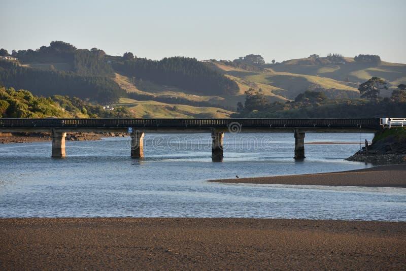 Bridge over harbour. Road bridge over Raglan harbour at low tide stock image