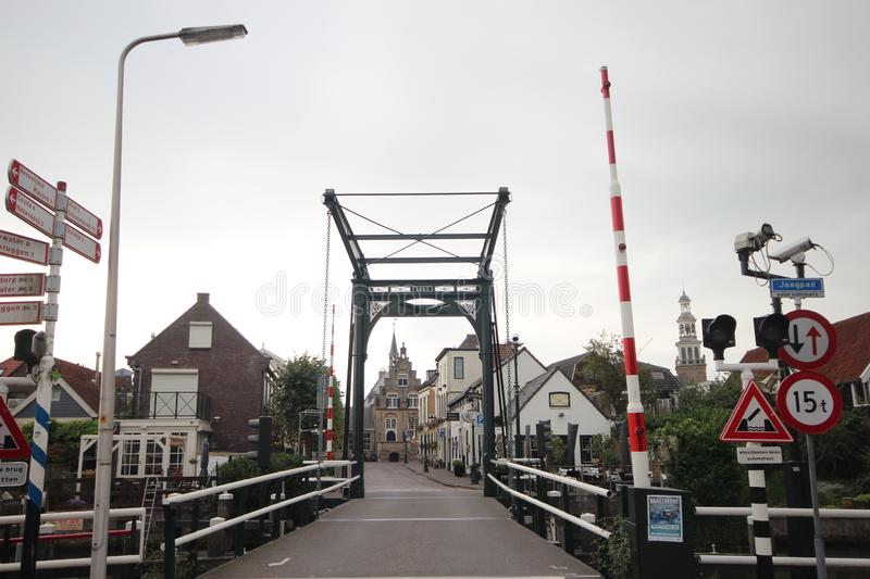 Bridge over Hollandsche IJssel and on background the city hall of Haastrecht stock images