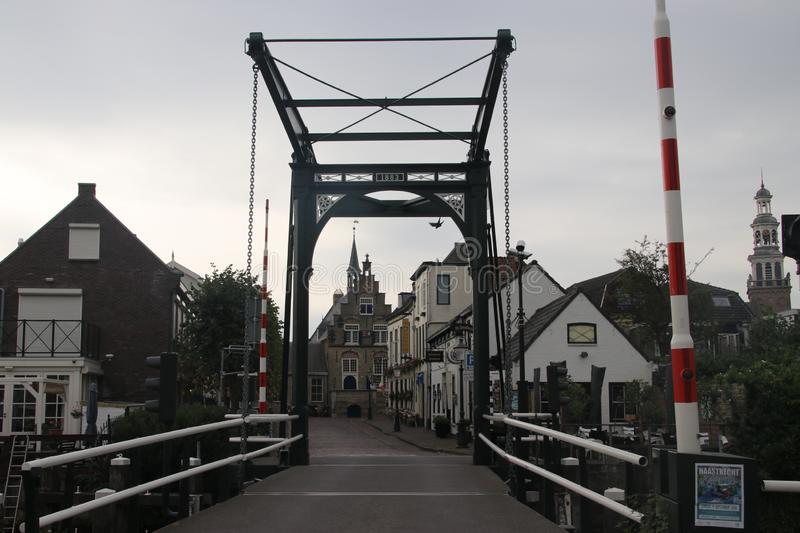 Bridge over Hollandsche IJssel and on background the city hall of Haastrecht royalty free stock images