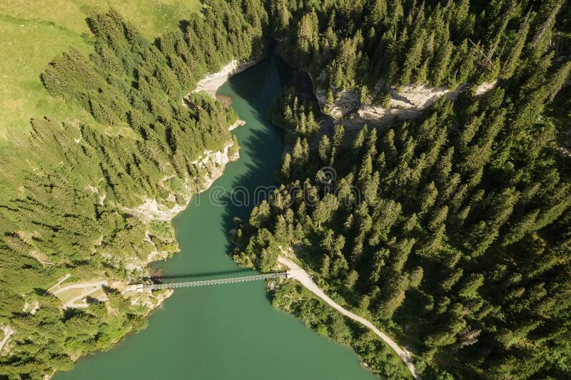 Bridge over Lac de Roselend lake in Savoie, France. Aerial view of bridge for pedestrians over Lac de Roselend lake in Savoie, France royalty free stock images