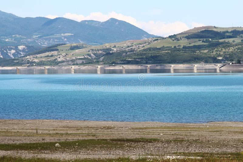 Bridge over Lake Serre-Poncon in France royalty free stock photography