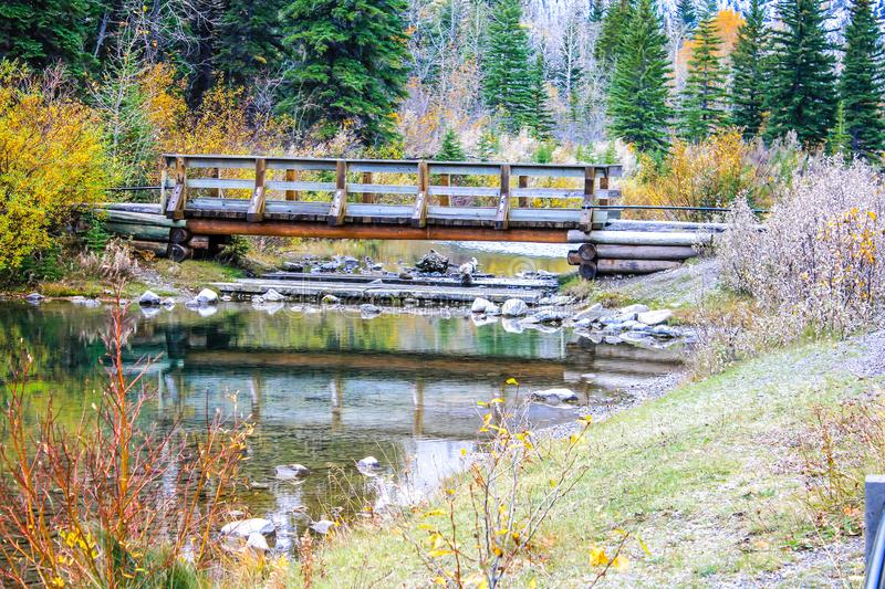 Mount Lorrett Ponds, Bow Valley Wilderness Area Area, Alberta, Canada. Bridge over mount lorett ponds in the late autum with fall colours royalty free stock photography