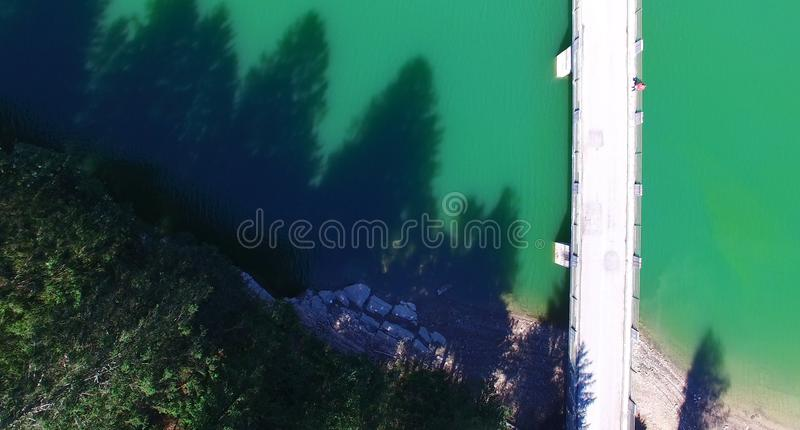 Bridge over mountain river, overhead aerial view royalty free stock photography