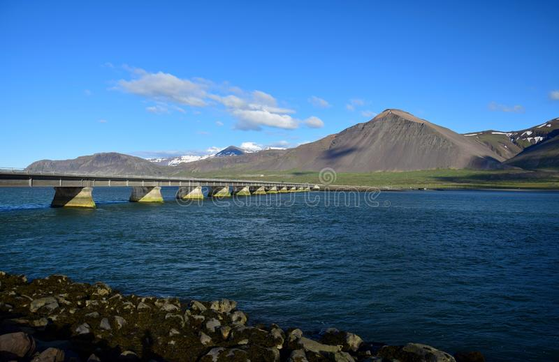 The bridge over the ocean leading to Borgarnes, a town in Iceland stock images