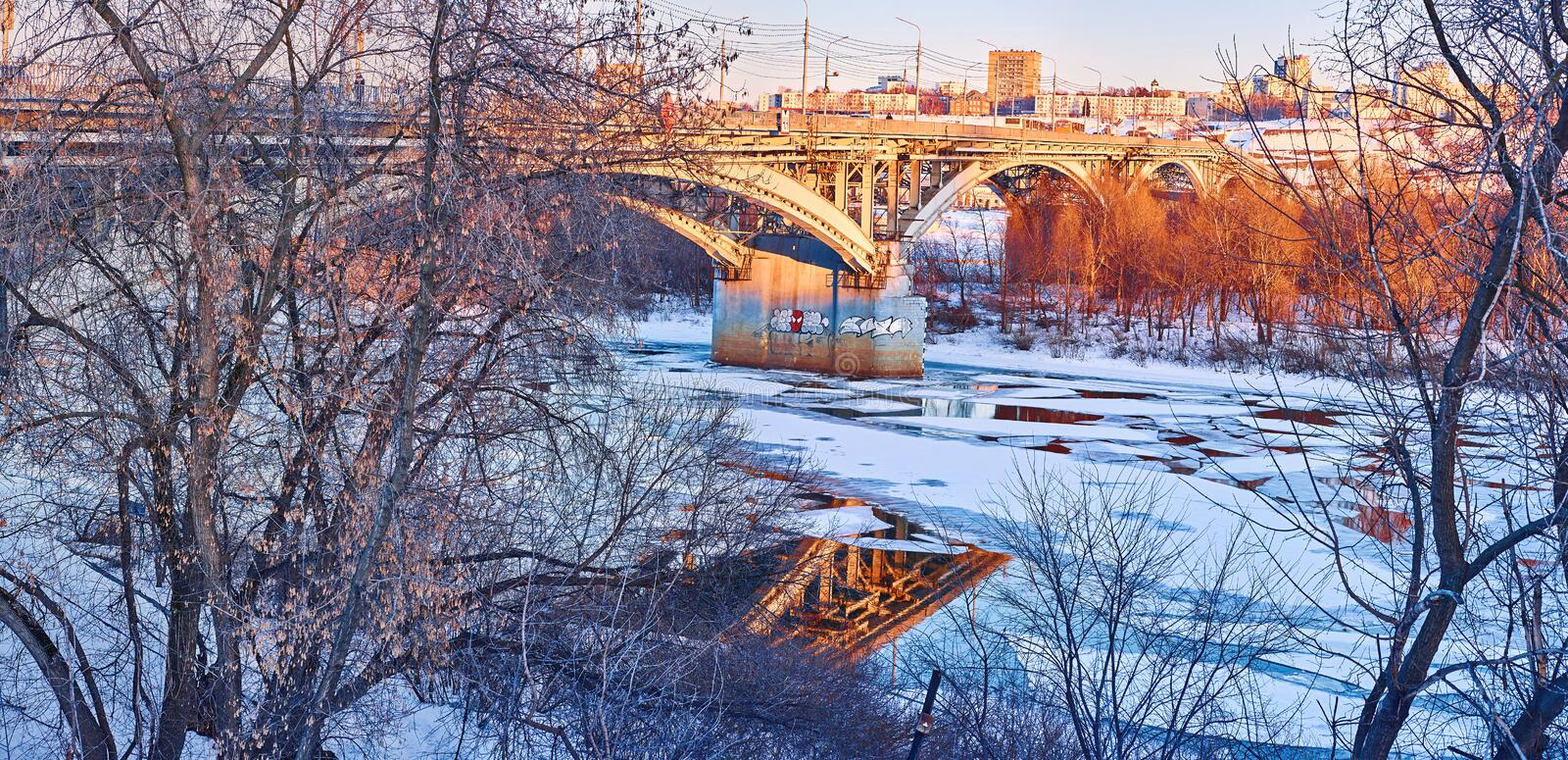 a bridge over the Oka River, floating ice floes royalty free stock photos