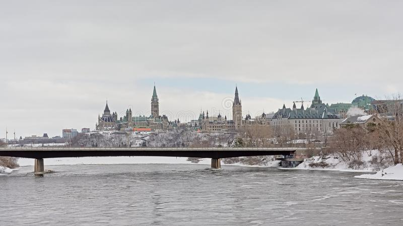 Bridge over Ottawa river, with Parliament hill and court building behind stock photos