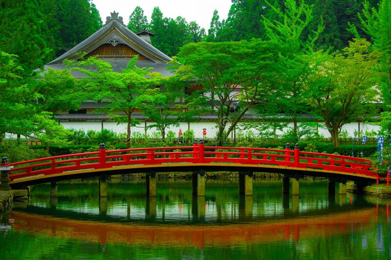 Bridge over pond and traditional oriental temple royalty free stock image