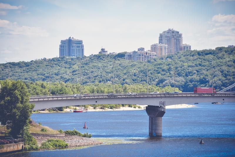 Bridge over river in big city. View of the bridge over the river in Kiev royalty free stock images