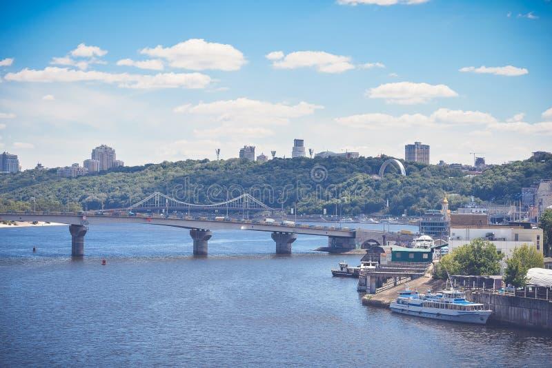 Bridge over river in big city. View of the bridge over the river in Kiev stock image