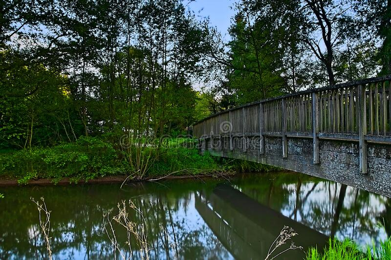 Bridge over a river in Germany. The bridge is located in Rieschweiler-Mühlbach, near Pirmasens. It crosses the Mühlbach .. The picture was taken in spring royalty free stock image