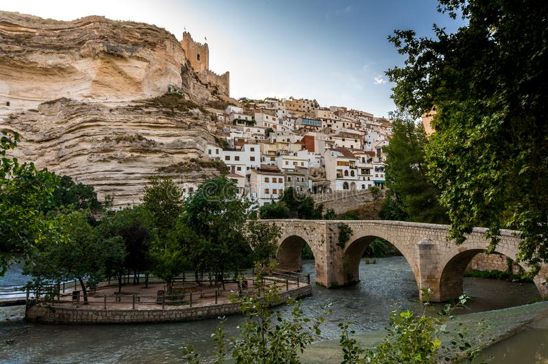 Bridge over the river Júcar with the castle on the rocks in Alcalá del Júcar in Albacete, Spain royalty free stock photography