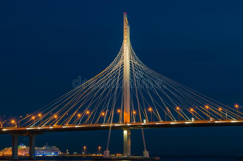 Bridge over the river at night on long exposure. Fragment of Cable-stayed bridge across the Petrovsky fairway. Saint Petersburg,. Russia stock photo