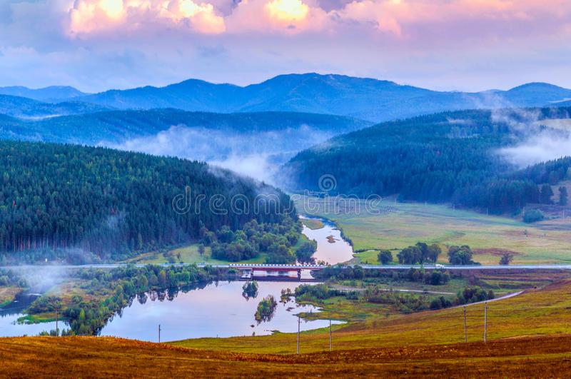 Bridge over river. The Ural Mountains. Bridge over the river in a picturesque valley. Ural mountains. Bashkortostan stock image