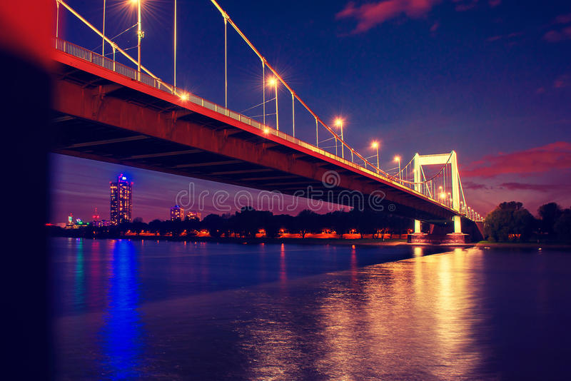 Bridge over the river Rhine. At night in Cologne, Germany stock photo