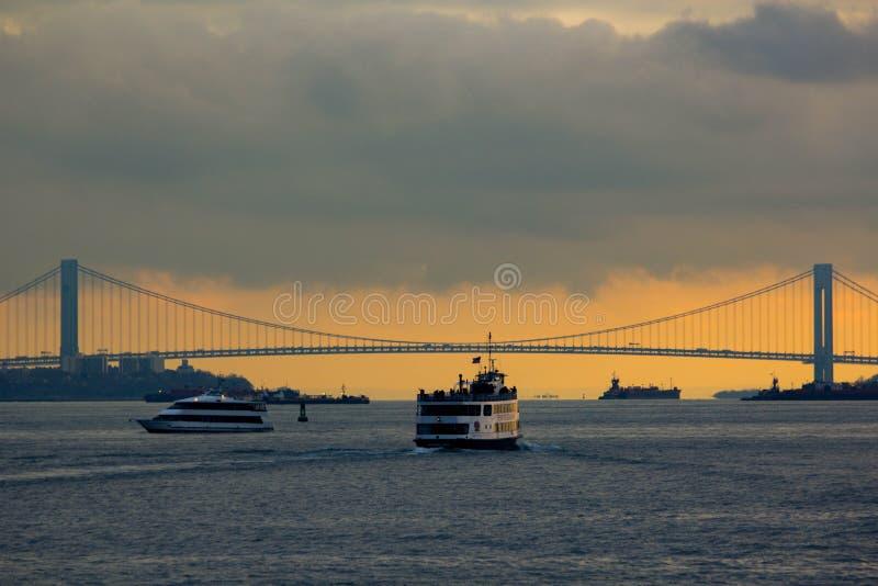 Bridge over river at sunset stock photos