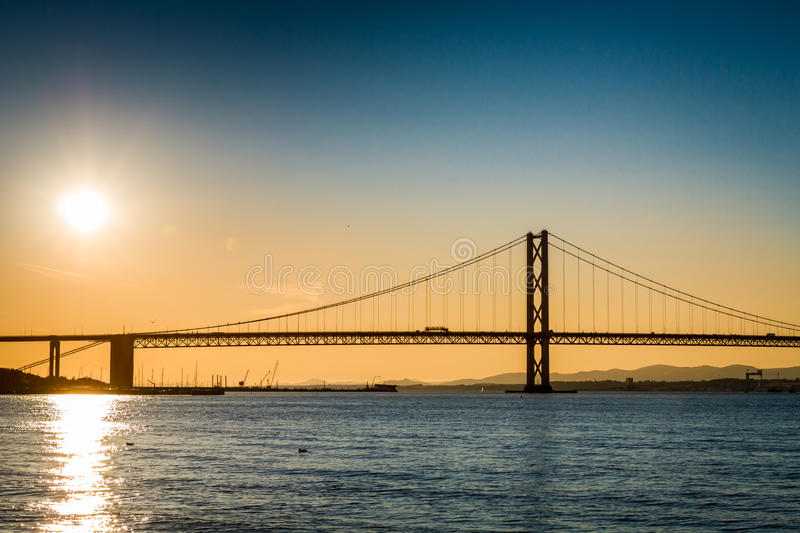 Bridge over river at sunset in Scotland royalty free stock photography