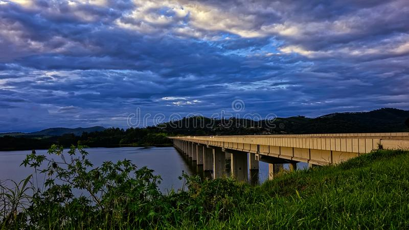 Bridge over river to sunset in the interior of the state of Sao Paulo, Brazil stock image