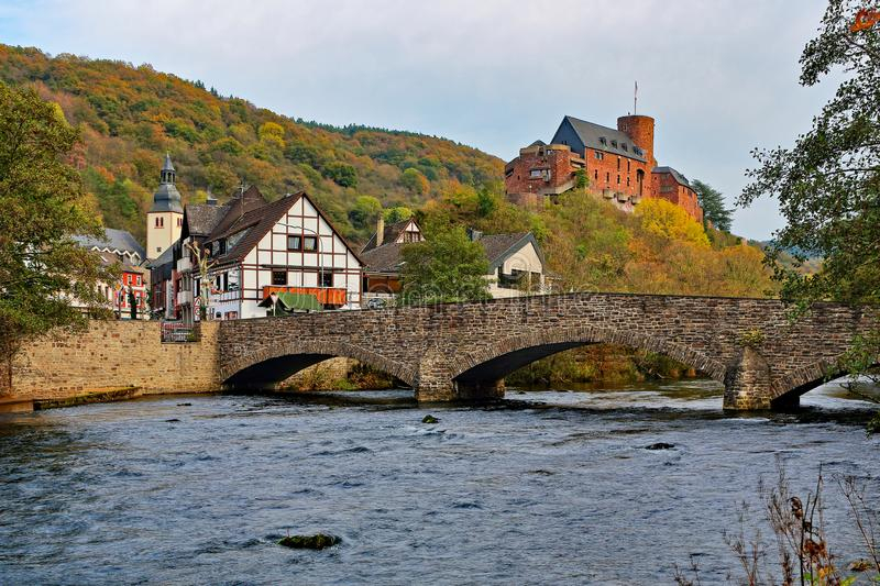 Bridge over the Rur in Heimbach and castle Hengebach in the background stock photography