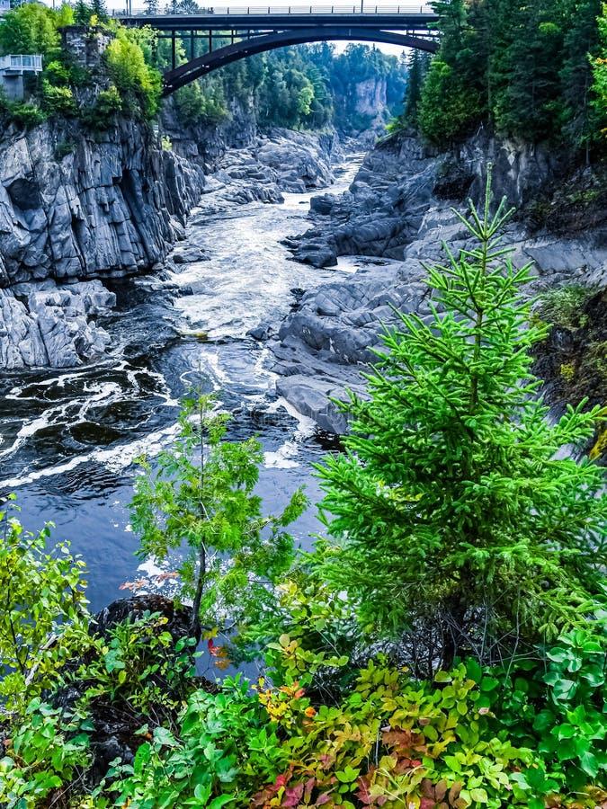 Bridge over the Saint John River in Grand Falls. View of the bridge over the Saint John River below the Grand Falls waterfall in New Brunswick, Canada, as it stock photo