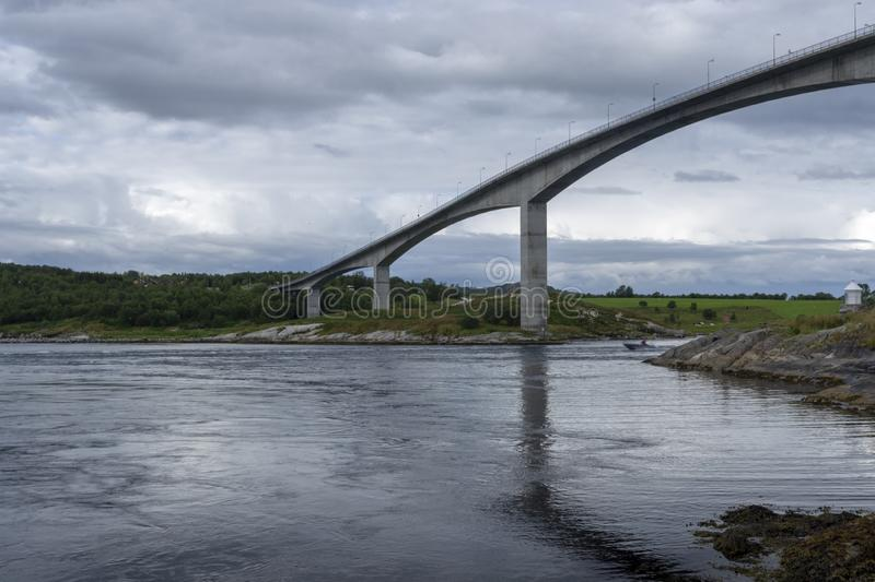 Bridge over Saltstraumen from North East. View to the South over Saltstraumen one of the strongest tidal current in the world with a boat driving down the stream stock photo