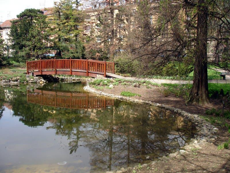 Bridge over small lake stock photography