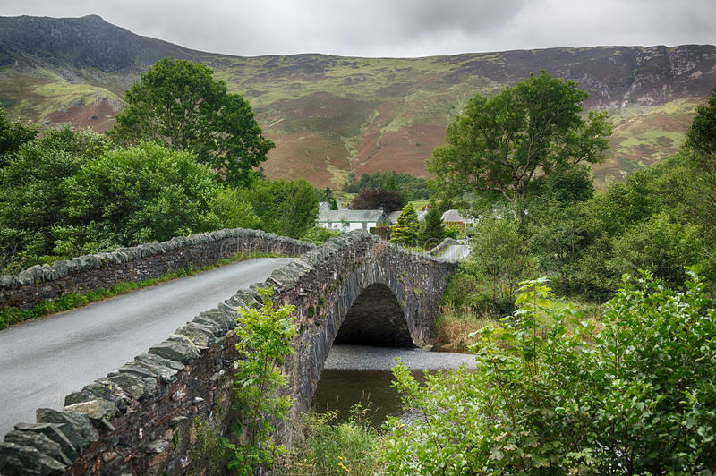 Bridge over small river at Grange in Lake District. Traditional stone Bridge at Grange in English Lake District royalty free stock photos