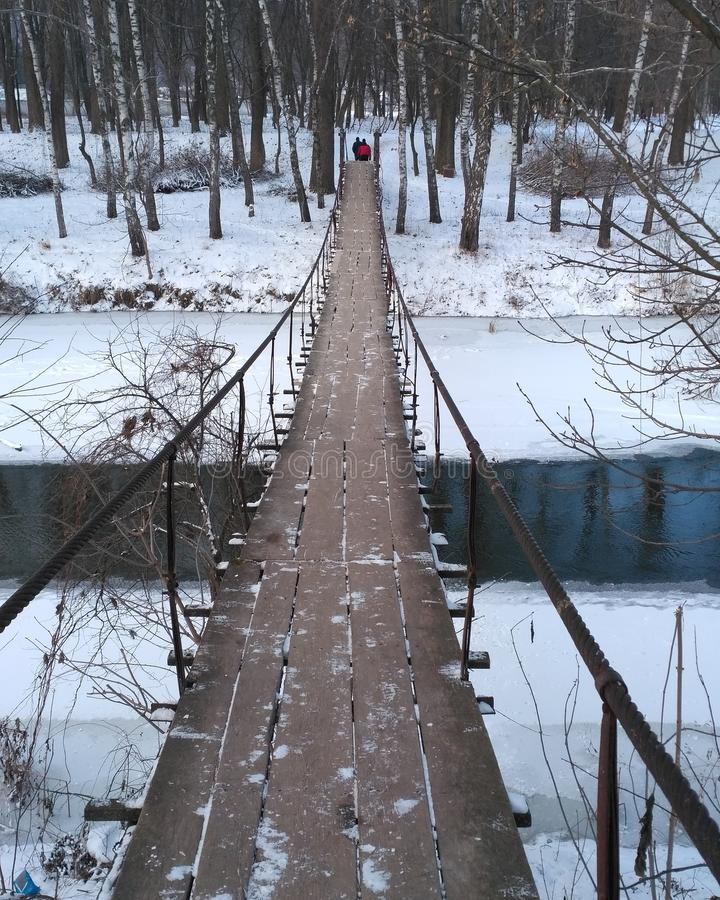 Bridge over the snowy river royalty free stock images