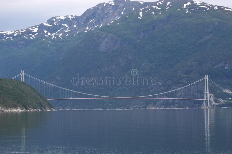Bridge over the Sorfjord in Norway, Scandinavia, Europe. The Sorfjord in Norway on a chilly and rainy day in August stock photos