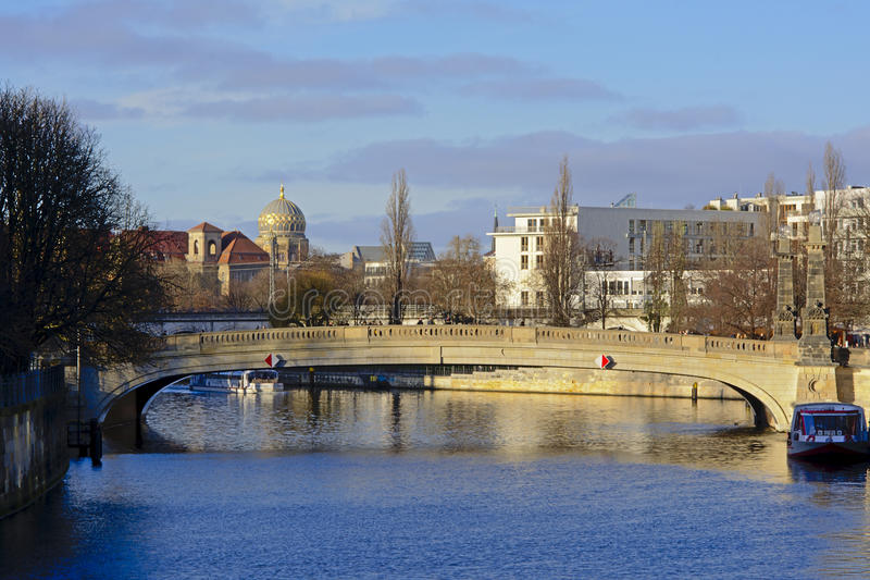 Bridge over Spree river with cupola of New Synagogue behind stock images
