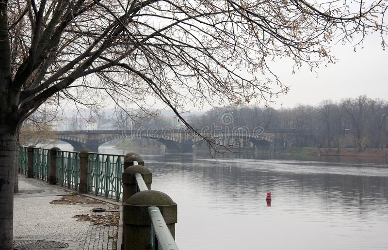 A bridge over the Vltava River in Prague in the fall stock photos