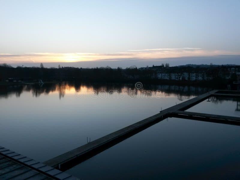 Bridge over water at sunset stock photo