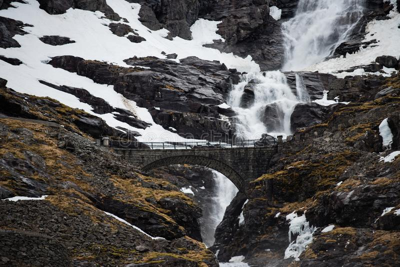 Bridge over a waterfall in Norway stock photos