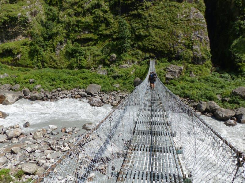 Bridge over wild river. Marsyangi river valley - Annapurna Circuit trek in Nepal royalty free stock photo