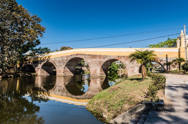 Bridge Over Yayabo River. Sancti Spiritus , Cuba / March 15, 2017: Declared a national monument in 1995, this is Cuba`s oldest bridge stock images