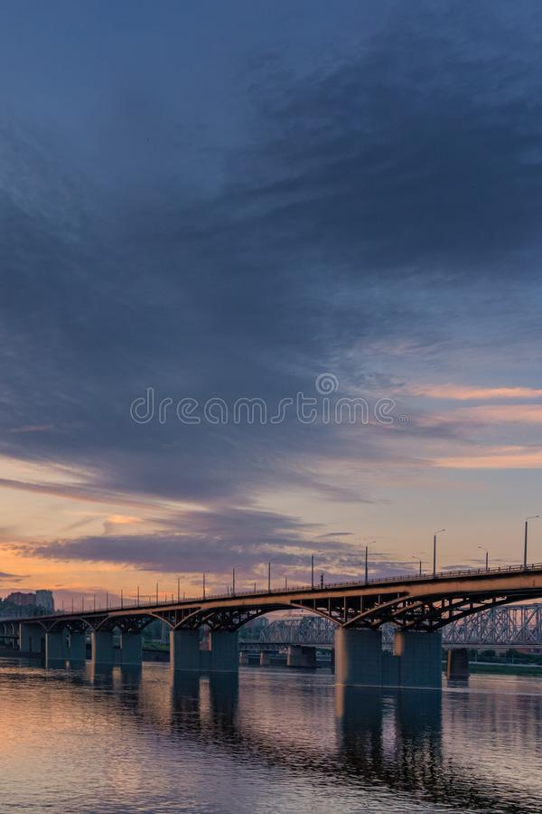 Bridge over the Yenisei river evening sunset. Krasnoyarsk, Russia. vertical stock images