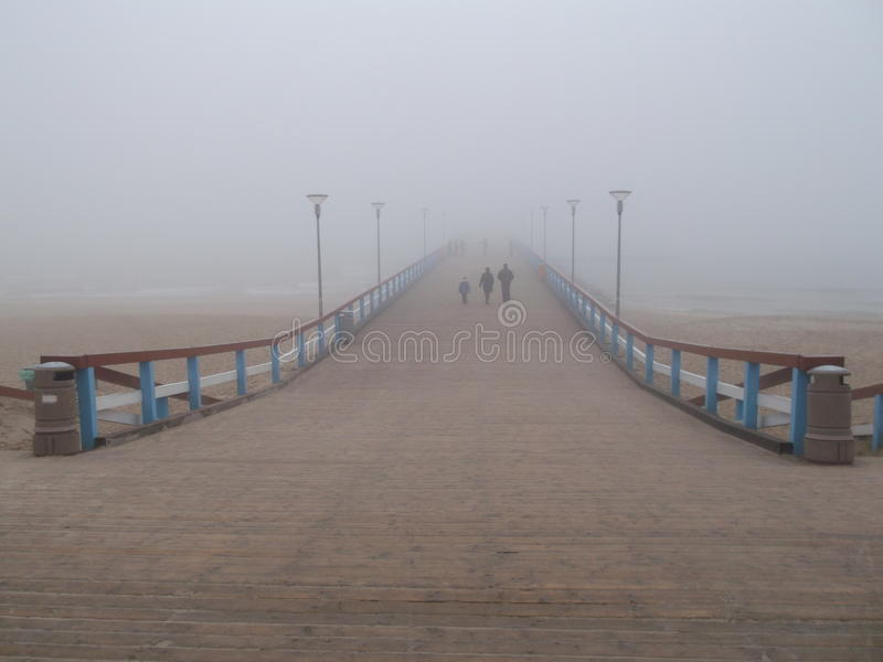Bridge in Palanga with fog royalty free stock photography