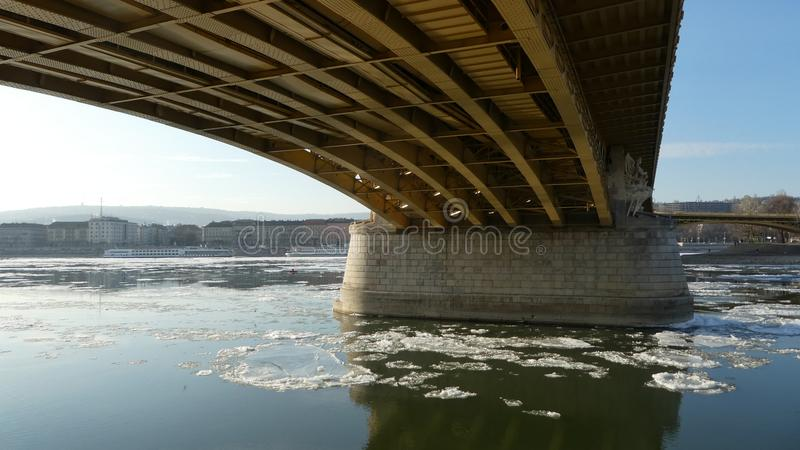 Budapest winter time - icy Danube, Margaret bridge icd blocks floating royalty free stock images