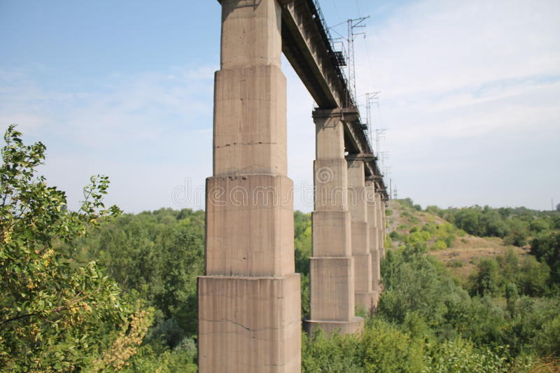 Bridge pillars. Lake nature tree water river column pole pile shaft pier belch stanchion rib travels tourism summer blue sky beautiful good weather stock photos