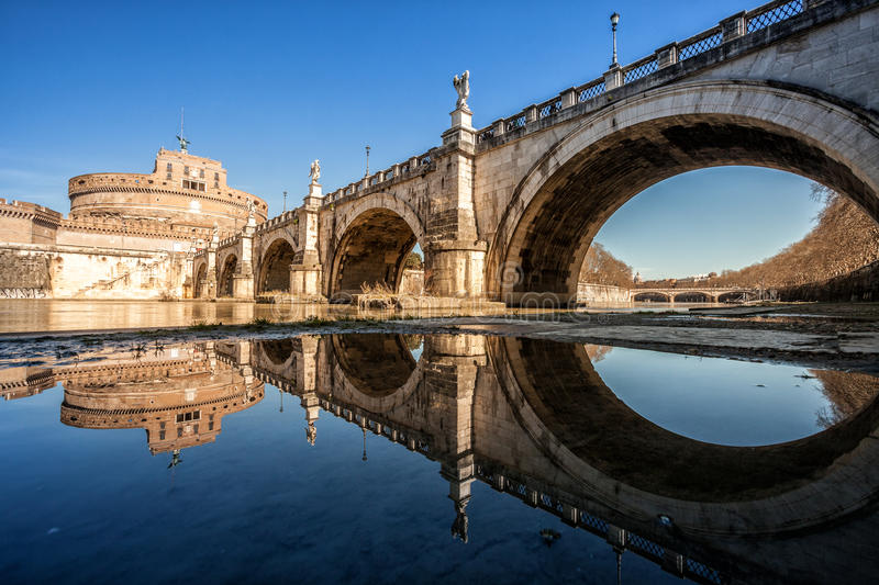 Bridge Ponte Sant' Angelo and castel. River Tiber. Rome, Italy. Ponte Sant'Angelo, once the Aelian Bridge or Pons Aelius, meaning the Bridge of Hadrian, is a stock photo