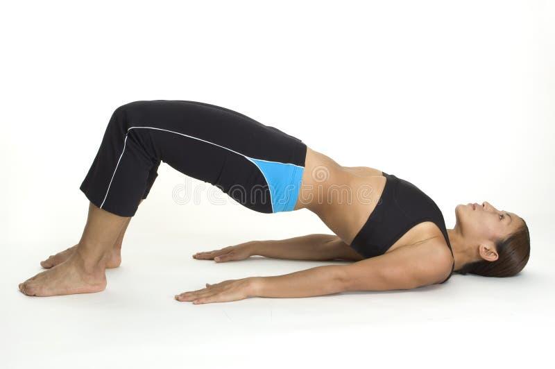 Bridge Pose 2. A female fitness instructor demonstrates the finishing position of the yoga bridge pose stock photo