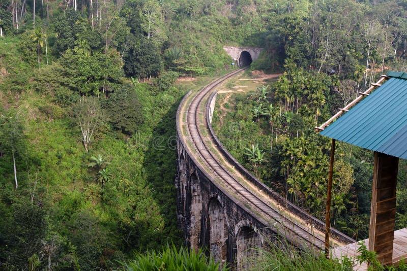 Bridge railways in the mountains, Ella, Sri Lanka. Arches Bridge in Demodara, Ella, railways Sri Lanka Mountain Palm landscape royalty free stock photo