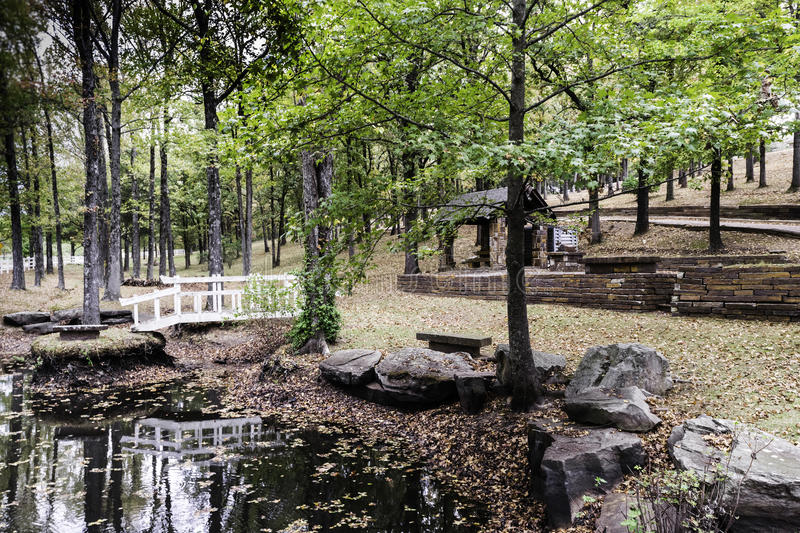Bridge and reflection pond in Ozark Mountains royalty free stock photo