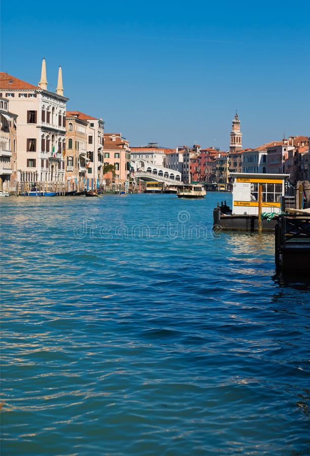 Bridge Rialto on Grand canal famous landmark panoramic view Venice Italy with blue sky white cloud and gondola boat water. royalty free stock photos