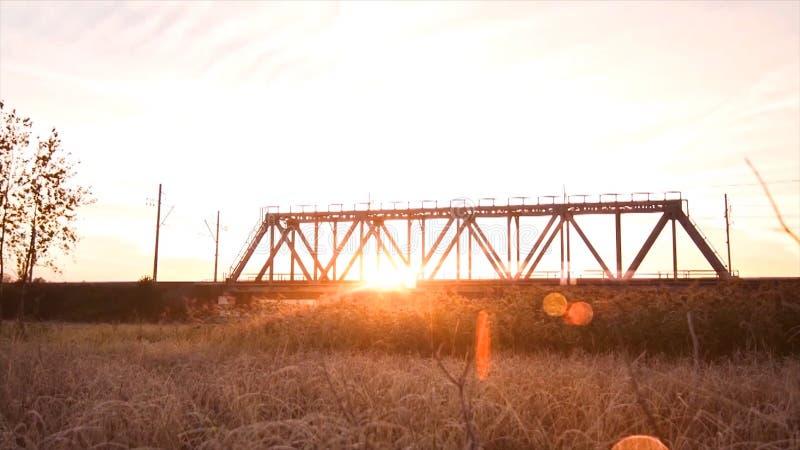 Bridge road. Train traffic transportation. Timelapse railway bridge on sunrise stock images